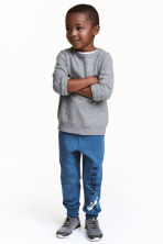 Printed joggers - Blue/Snoopy - Kids | H&M 1