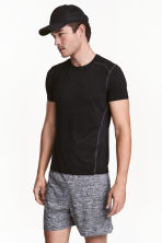 Sports shorts - Black marl - Men | H&M CN 1
