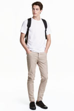 Twill trousers Slim fit - Light beige - Men | H&M CN 1