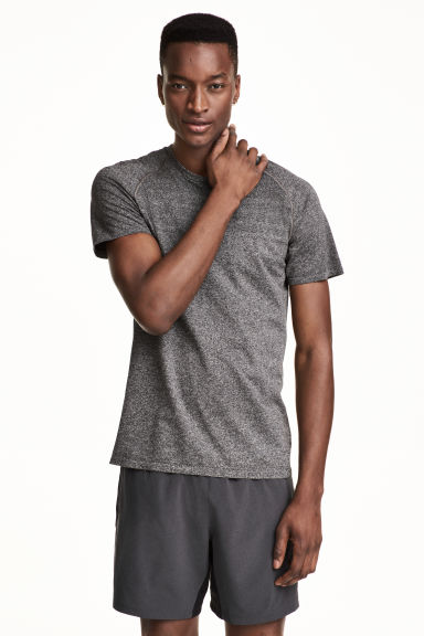 Seamless running top - Black marl - Men | H&M CN 1