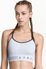 Sports bra Low support - Light grey marl - Ladies | H&M CN 1