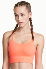 Sports bra Low support - Neon coral - Ladies | H&M CN 1
