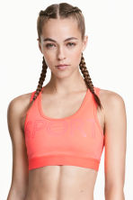 Sports bra Medium support - Neon coral - Ladies | H&M 1