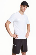 Knee-length sports shorts - Black - Men | H&M CN 1