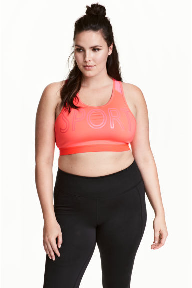 H&M+ Sports bra Medium support - Neon coral - Ladies | H&M