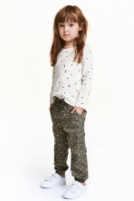 Pull-on trousers - Khaki green/Hearts - Kids | H&M CN 1