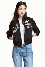 Bomber jacket with appliqués - Black - Ladies | H&M 1