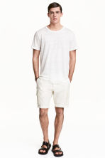 Knee-length shorts - Natural white - Men | H&M 1
