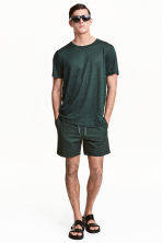 Short cotton shorts - Dark green - Men | H&M 1