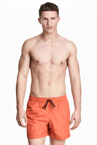 Short swim shorts - Orange - Men | H&M 1
