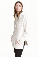 Hooded top with side slits - White - Ladies | H&M CN 1