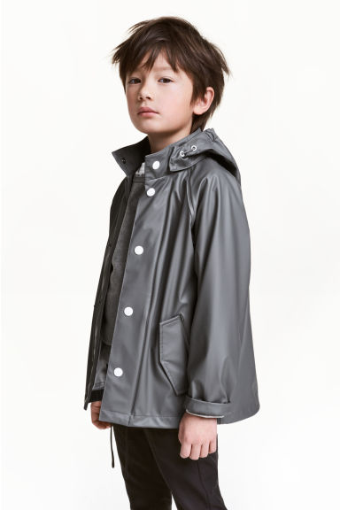 Rain jacket with a hood - Dark grey - Kids | H&M 1