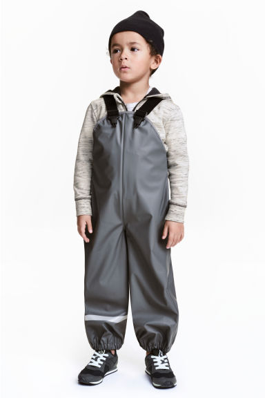 Rain trousers with braces - Dark grey - Kids | H&M 1