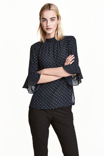 Blouse with flounced sleeves