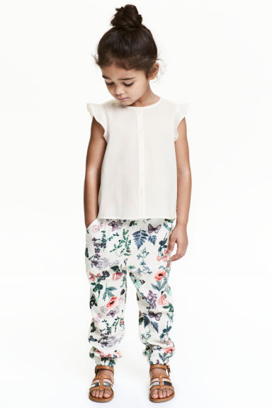 Patterned pull-on trousers - Natural white/Floral - Kids | H&M CA 1