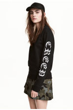 Printed sweatshirt - Black - Ladies | H&M 1