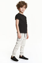 Sweatpants - Natural white marl - Kids | H&M 1