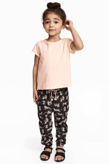 Pull-on trousers - Black/Leopards - Kids | H&M 1