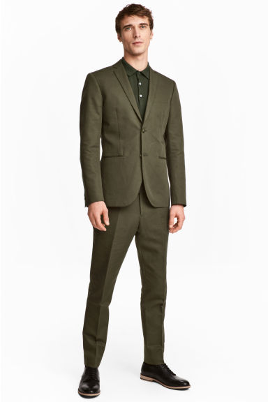 Suit trousers in a linen blend - Khaki green - Men | H&M