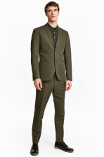 Suit trousers in a linen blend - Khaki green - Men | H&M 1