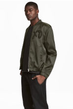 Bomber jacket - Dark khaki green/XO - Men | H&M 1