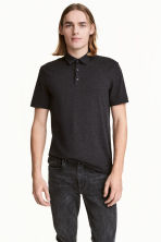 Polo shirt Slim Fit - Black/Narrow striped - Men | H&M 1