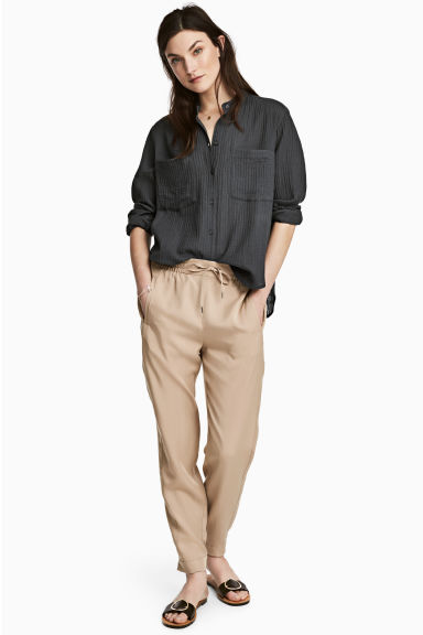 Pantaloni pull-on in lyocell - Beige - DONNA | H&M IT 1
