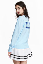 Printed sweatshirt - Light blue - Ladies | H&M CN 1