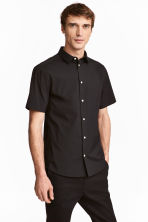Short-sleeved stretch shirt - Black - Men | H&M 1