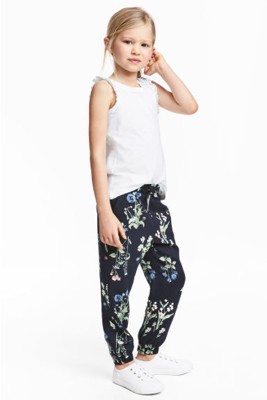 Patterned pull-on trousers - Dark blue/Floral - Kids | H&M 1