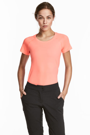 Seamless sports top - Neon coral - Ladies | H&M CN