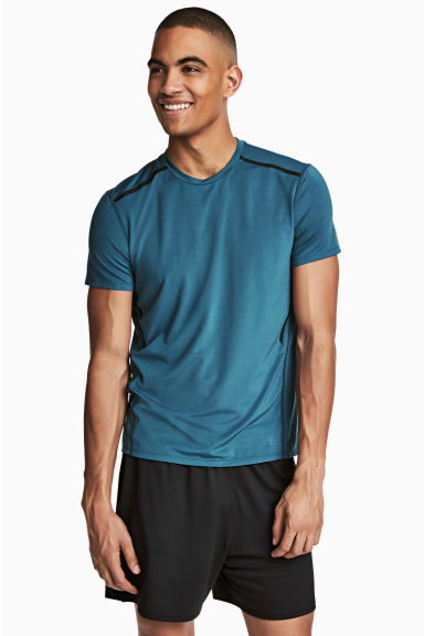 Short-sleeved sports top - Petrol blue - Men | H&M CN 1