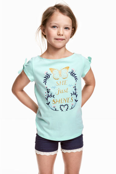 Top in jersey con stampa - Verde menta/farfalla -  | H&M IT 1