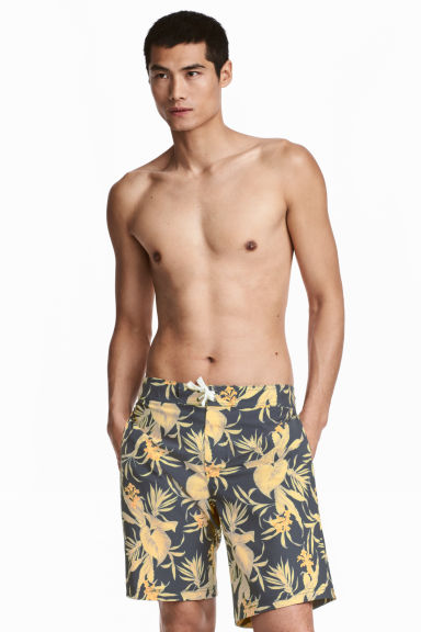 Knee-length swim shorts - Dark blue/Floral - Men | H&M CN