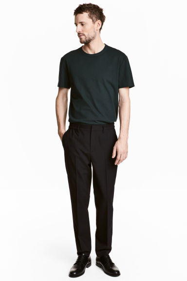 Elasticated trousers in wool - Black - Men | H&M CA 1