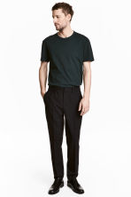 Elasticated trousers in wool - Black - Men | H&M 1