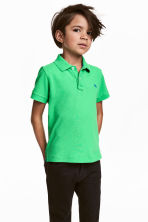 Polo shirt - Bright green - Kids | H&M 1