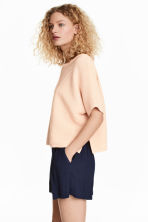 Textured short-sleeved jumper - Light apricot - Ladies | H&M 1