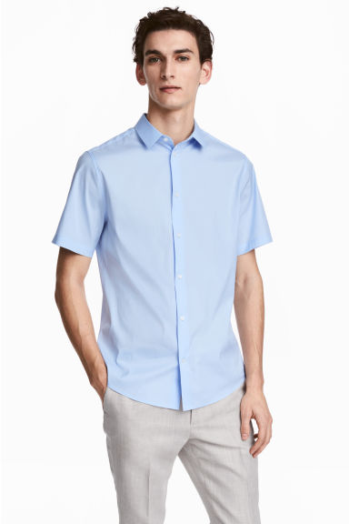 Short-sleeved stretch shirt - Light blue - Men | H&M 1