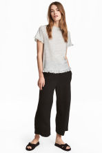 Pantaloni con volant - Nero - DONNA | H&M IT 1