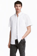 Camisa Regular fit - Blanco - HOMBRE | H&M ES 1