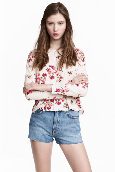 Blouse with a flounced hem - Natural white/Floral - Ladies | H&M 1