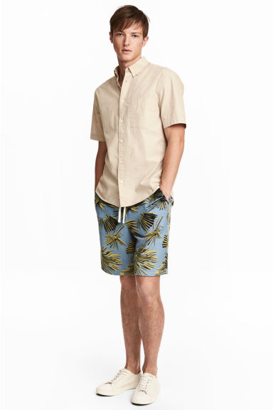 Knee-length sweatshirt shorts - Blue/Palm leaves - Men | H&M 1