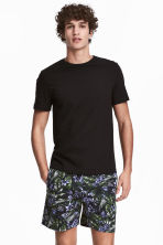 Pyjama shorts - Black/Patterned - Men | H&M CN 1