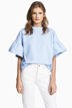 Top with flounced sleeves - Light blue - Ladies | H&M CN 1