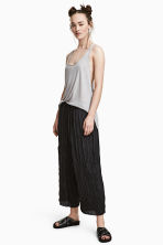 Crinkled ankle-length trousers - Black - Ladies | H&M 1