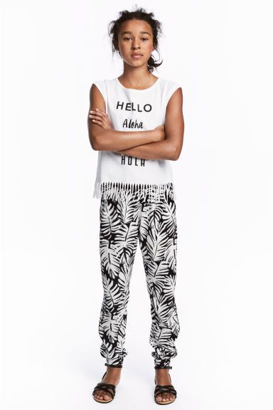 Patterned trousers - Black/Leaf -  | H&M 1