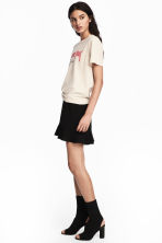 Short flounced skirt - Black - Ladies | H&M 1