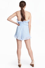 Crêpe playsuit met volants - Lichtblauw - DAMES | H&M BE 1