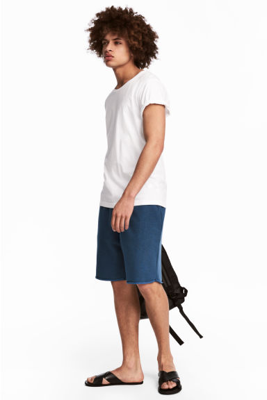 Knee-length sweatshirt shorts - Navy blue - Men | H&M